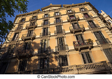 One of the typical old residential buildings in the historical center of Barcelona in sunny day. Spain.