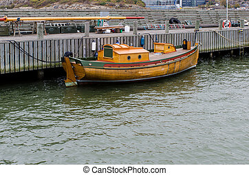 one old boat of wood in the harbour