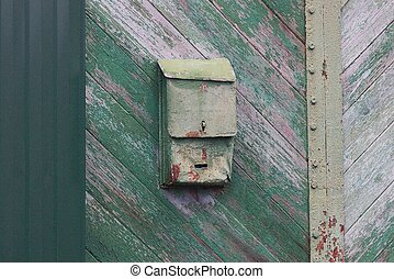 one old green metal mailbox