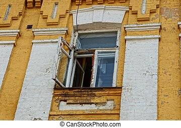 one old open window on the brick wall of the house