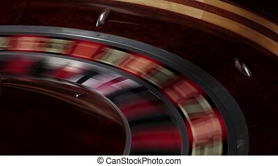 One part of roulette wheel running, white ball falls - One...
