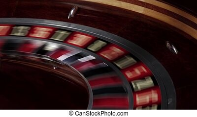One part of roulette wheel starts running, numbers, close up...