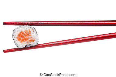 One peace of salmon sushi maki in wooden brown chopsticks isolated on white background