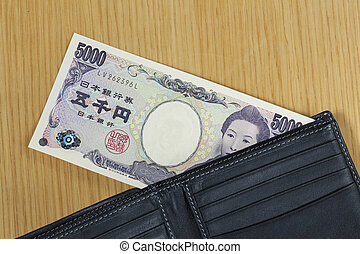 one peice of five thousand Japanese cashes wallet close up