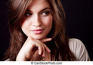 One pensive elegant beautiful woman