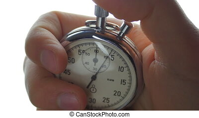 One person starting up a stopwatch at isolated background - ...
