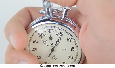 One person starting up a stopwatch at white background -...