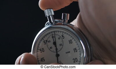 One person starting up a stopwatch. - person starting up a ...