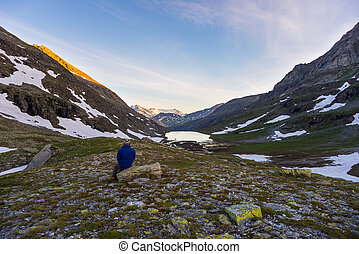 One person watching sunrise high up in the Alps