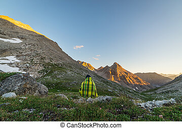 One person watching sunset in the Alps