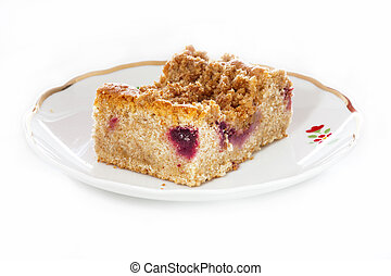 One piece of fresh Plum crumble cake on a plate isolated on ...