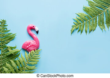One pink flamingo candy lollipop on blue. Top view. Fun tropical vacation concept.