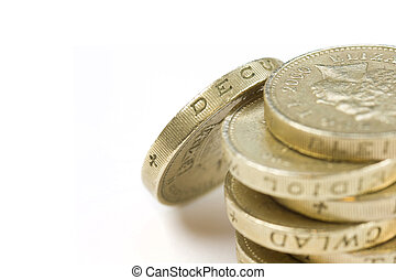 One pound coin - Stack of One pound coins on a white...