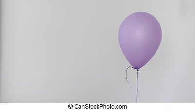 One purple balloon white wall background - One purple...