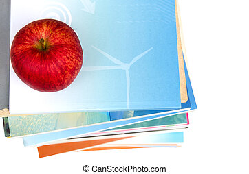 red apple on top of book stack