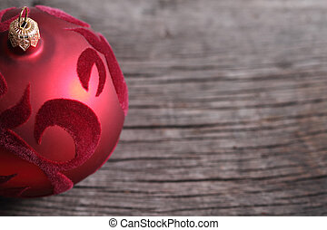 One red christmas ball on the wooden background