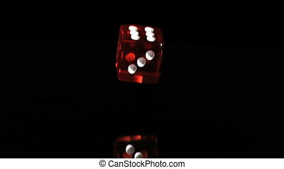 One red dice in a super slow motion rebounding