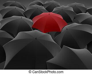 One red umbrella among set of other black - Many black...