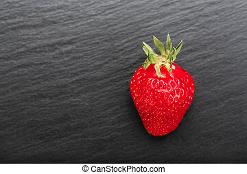 strawberry on a black background