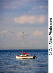 One Sailboat Moored at Sea