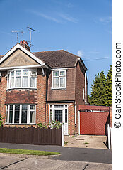 One side of a semi detached house with blue sky