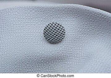 one small round black white button