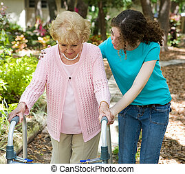 One Step at a Time - Senior woman struggles to walk with the...