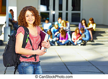 One student in front of group