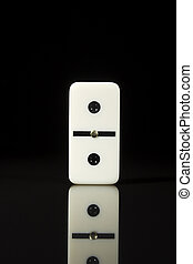 One tile dominoes - One domino tile on a black reflective ...
