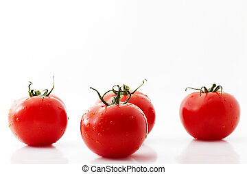 one tomato and three tomatos on white background