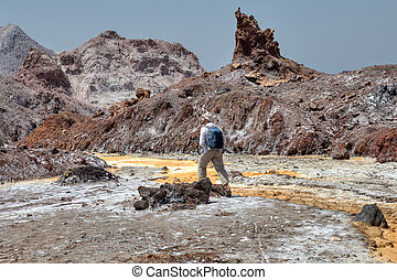One traveler walking along the bed of Yellow River, Iran.