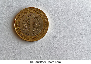One Turkish coin denomination is 1 lira lie on isolated white background