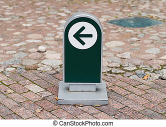 small one way sign at the museum brick road