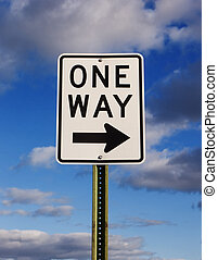One Way - One way sign with a cloudy blue sky background