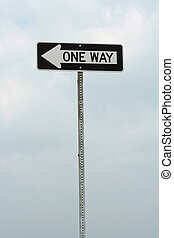 One way sign against cloudy sky
