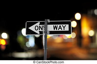 """One way sign - """"one way"""" sign on pole in street in u.s.a."""