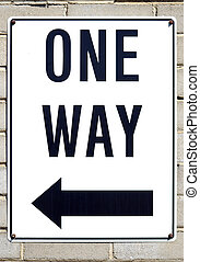 One way sign. - One way sign with direction indicated by an ...