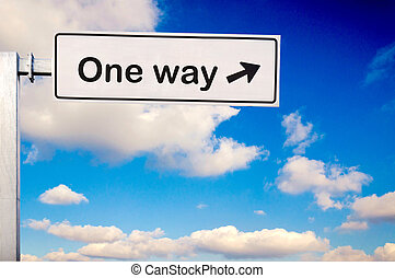 One way sign over the sky