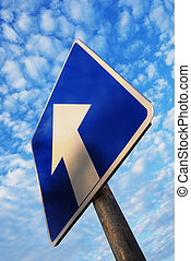 one way sign under blue sky