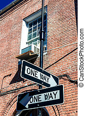 One way street sign in new Orleans with historical classic building on background
