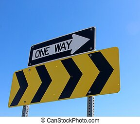 One Way - The one way sign with the blue sky background.