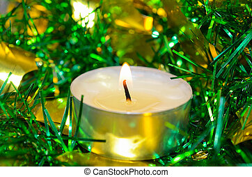 One white candle with  tinsel
