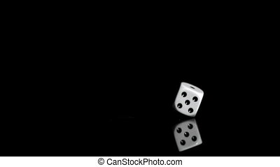 One white dice in a super slow motion even turning on