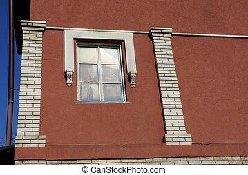 one white window on the brown wall