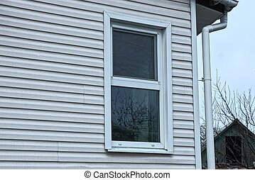 one white window on the gray plastic wall