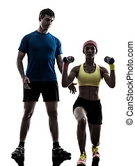 one woman exercising fitness weight training with man coach...
