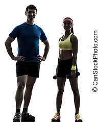 woman exercising fitness workout with man coach posing
