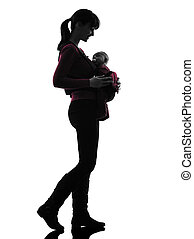 woman mother walking baby silhouette - one woman mother...