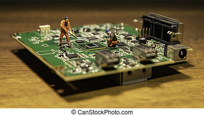 One worker model with digging fork on circuit board