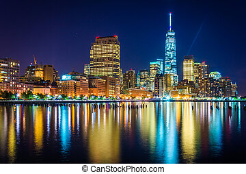 One World Trade Center and Battery Park City at night, seen from Pier 34, Manhattan, New York.